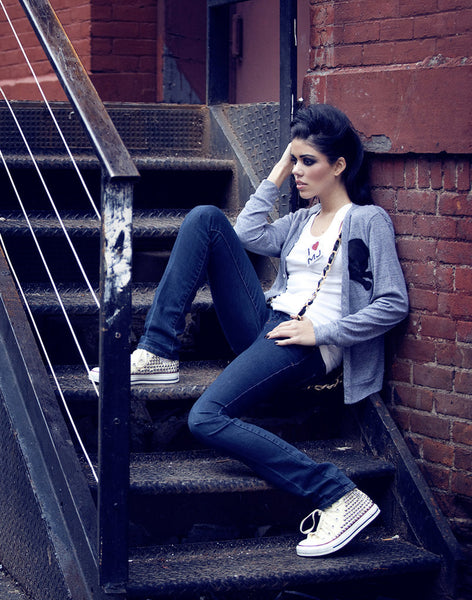 Model wearing women's custom studded converse sneakers