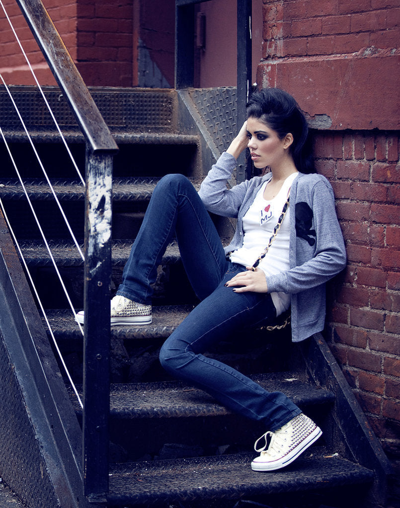 Model wearing studded converse