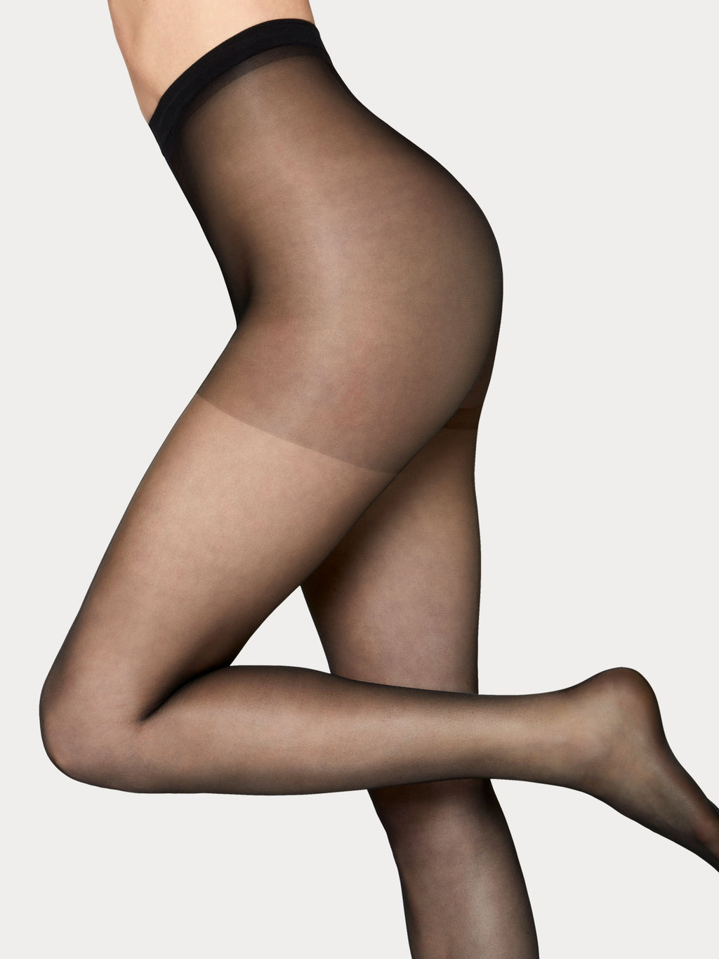 Vogue hosiery elegant 20 denier matt tights with invisble light shaping section.