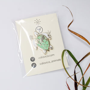 Enamel pin sea turtle with world map
