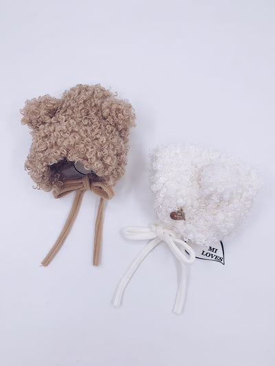 MI LOVES SIGNATURE Faux fur shearling hat.