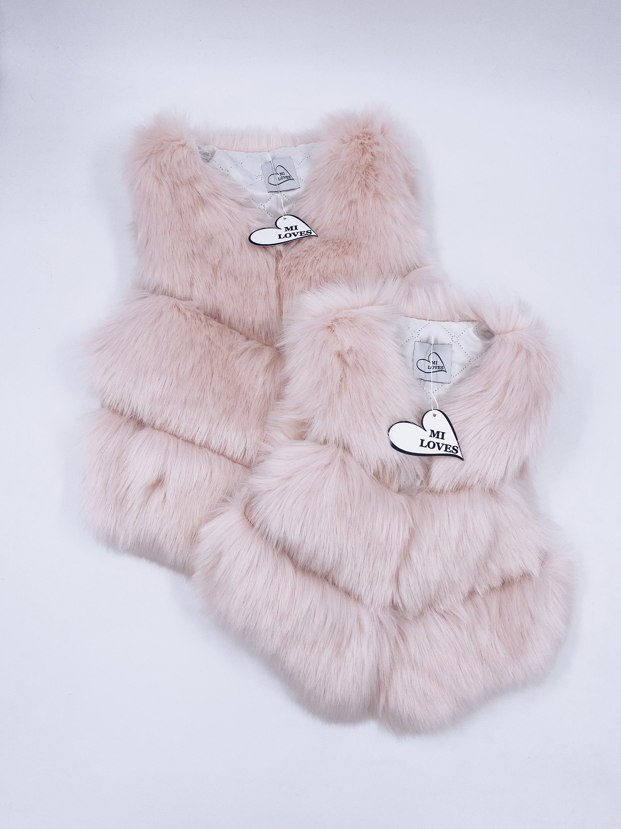 MI LOVES SIGNATURE Adult Synthetic fur vest in Pink.
