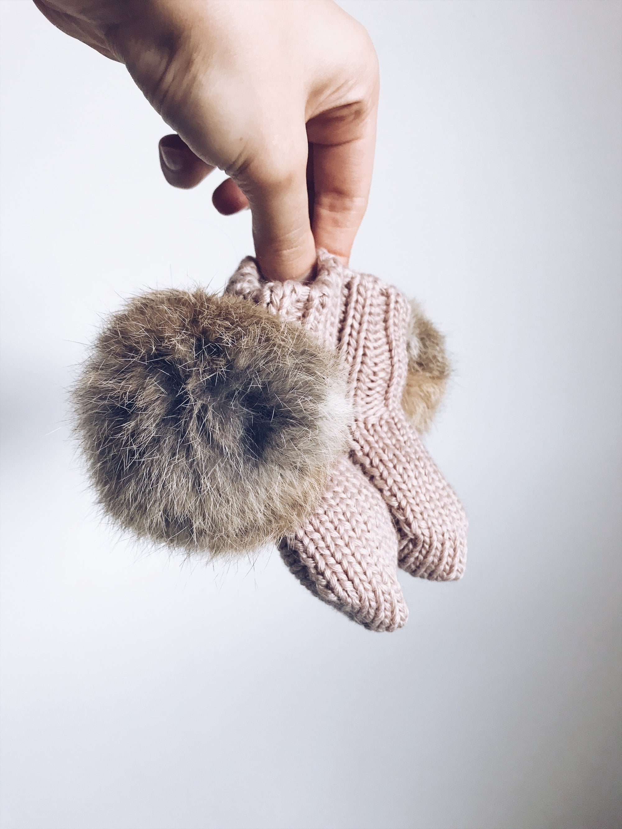 MILOVES Signature Hand Knitted baby booties with rabbit fur pompoms