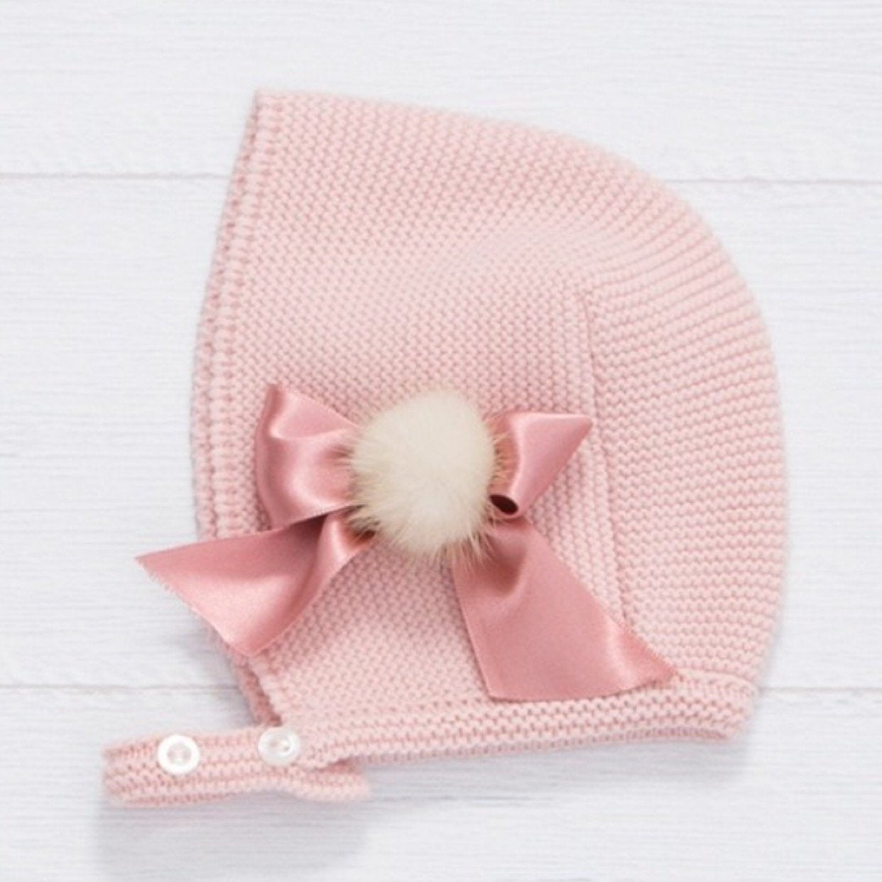 Knitted Baby bonnet with bow and pompom
