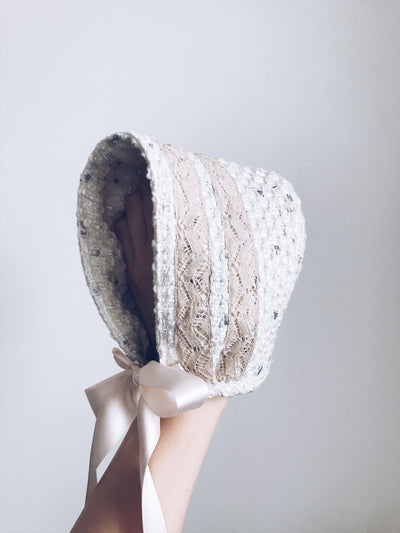 Beautiful Cream bonnet with cream lace details.