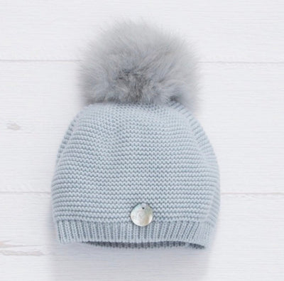 Knitted hat with fox fur pompom