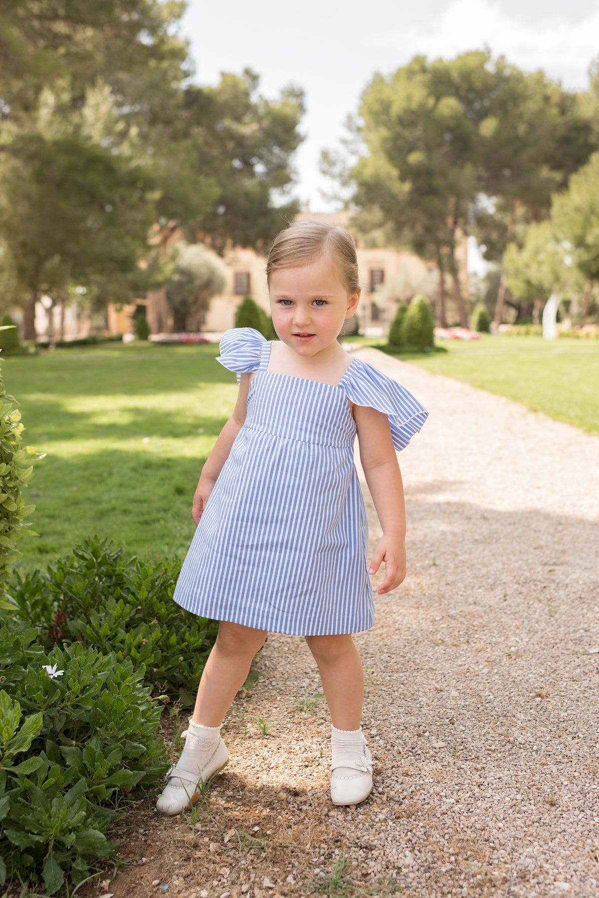 Dolce Petit SS2020 Blue/White stripes sun dress with bow details on the back.