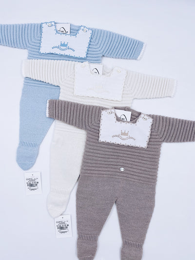 Beautiful knitted baby grow with crown details.