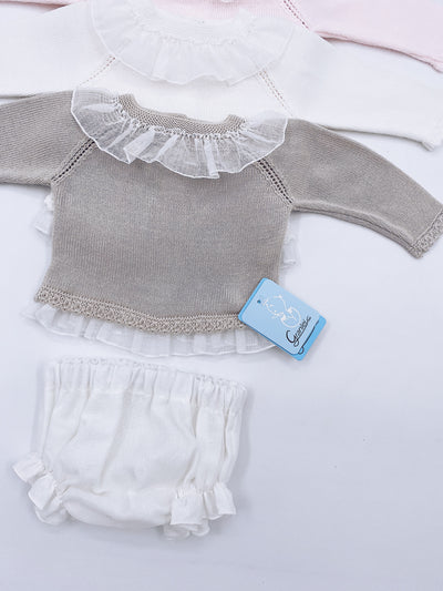 Beautiful knitted jumper and shorts set .