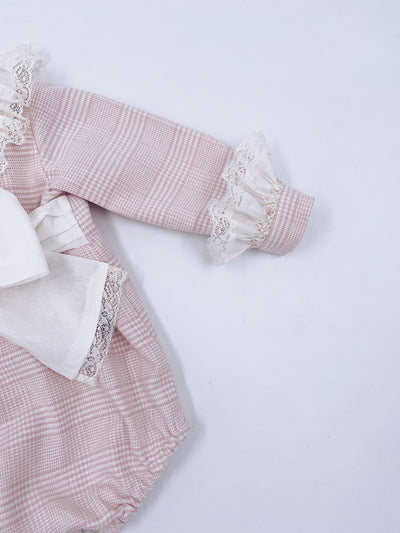 Beautiful Baby pink romper with hand smoking and lace details.