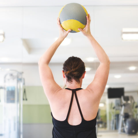 Woman Lifting Exercise Fitness Ball For Weight Loss