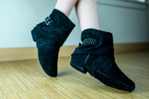 Aurora dance boots black pair folded down angled shot on wood floor