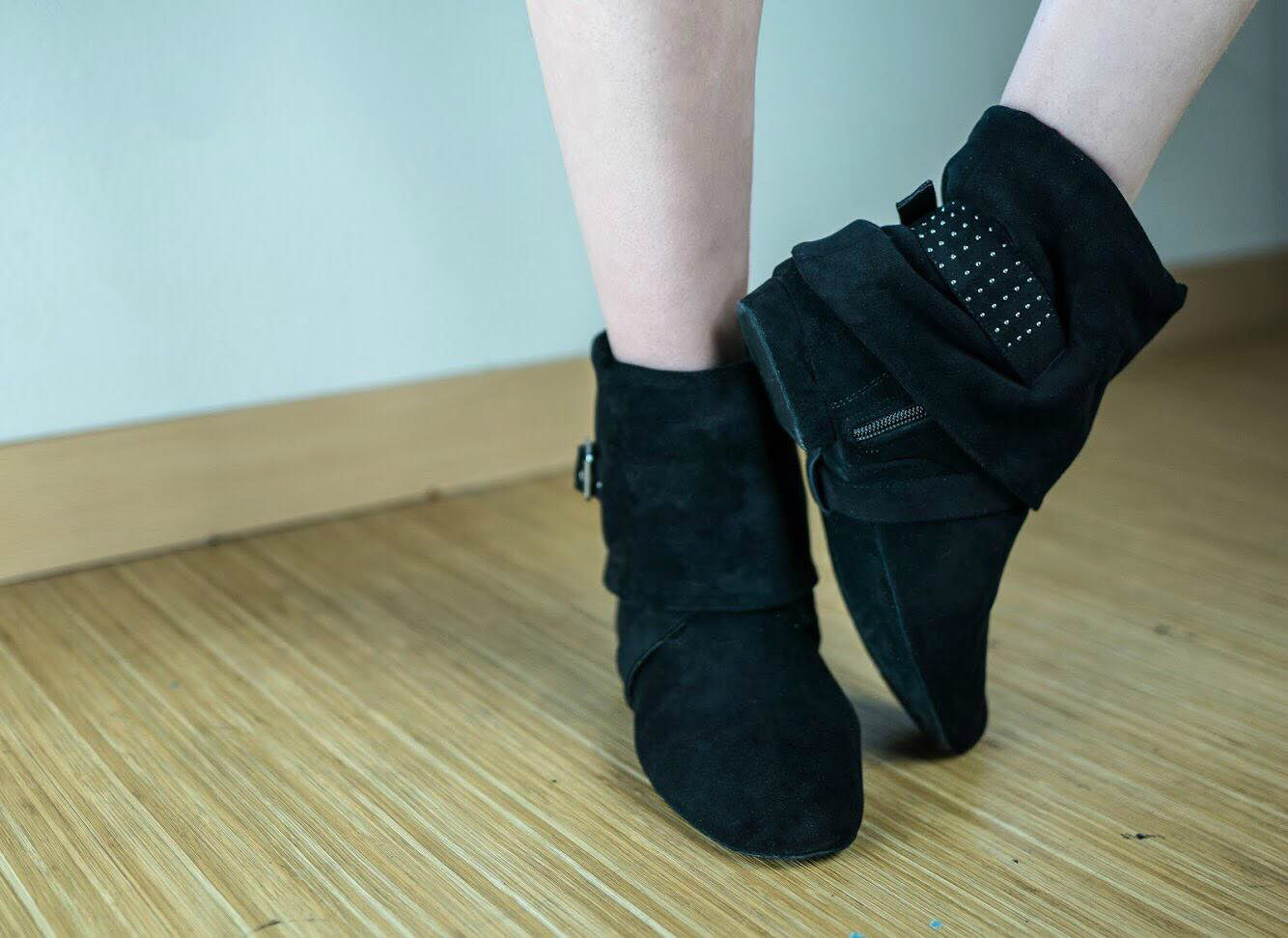 Aurora dance boots black pair folded down on wood floor