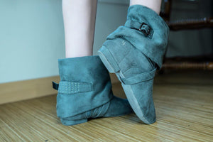 Aurora dance boots grey pair folded down against wooden floor, logo