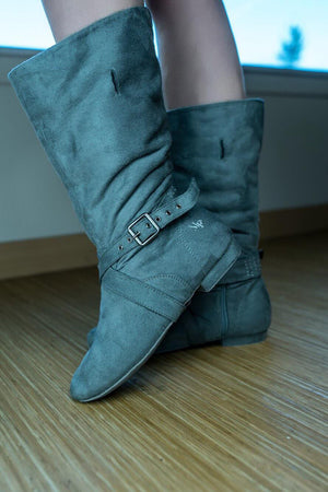 Aurora dance boots grey pair folded up against wooden floor