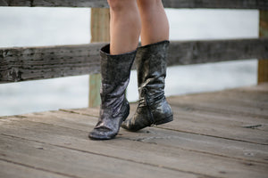Aurora dance boots silver metallic pair folded up in action on wooden dock