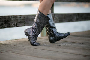 Aurora dance boots silver metallic pair folded up apple jacks wooden dock background