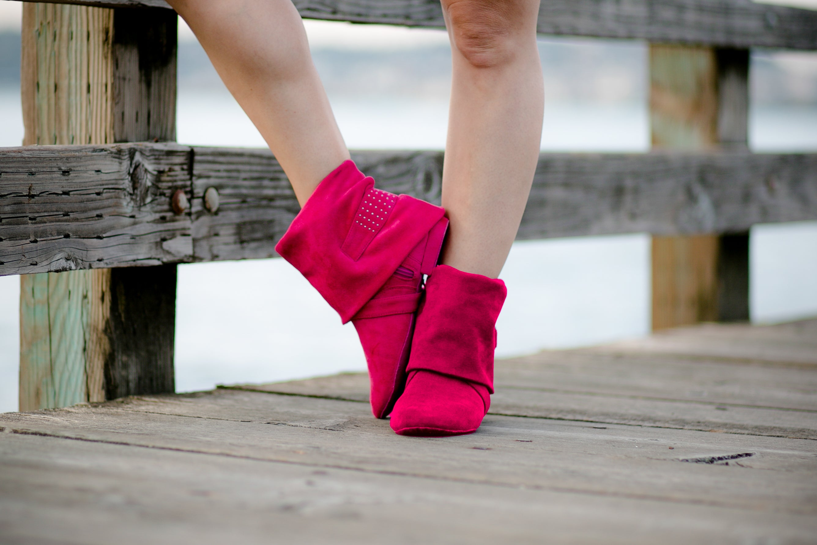 Aurora Dance Boots fuchsia pair with wooden dock background