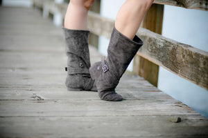 Aurora dance boots dark grey charcoal pair folded up, wooden dock background