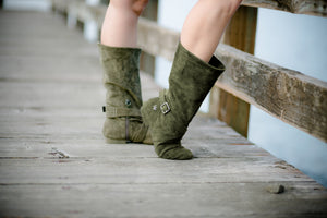 Aurora dance boots dark/olive green pair folded up on wooden dock background