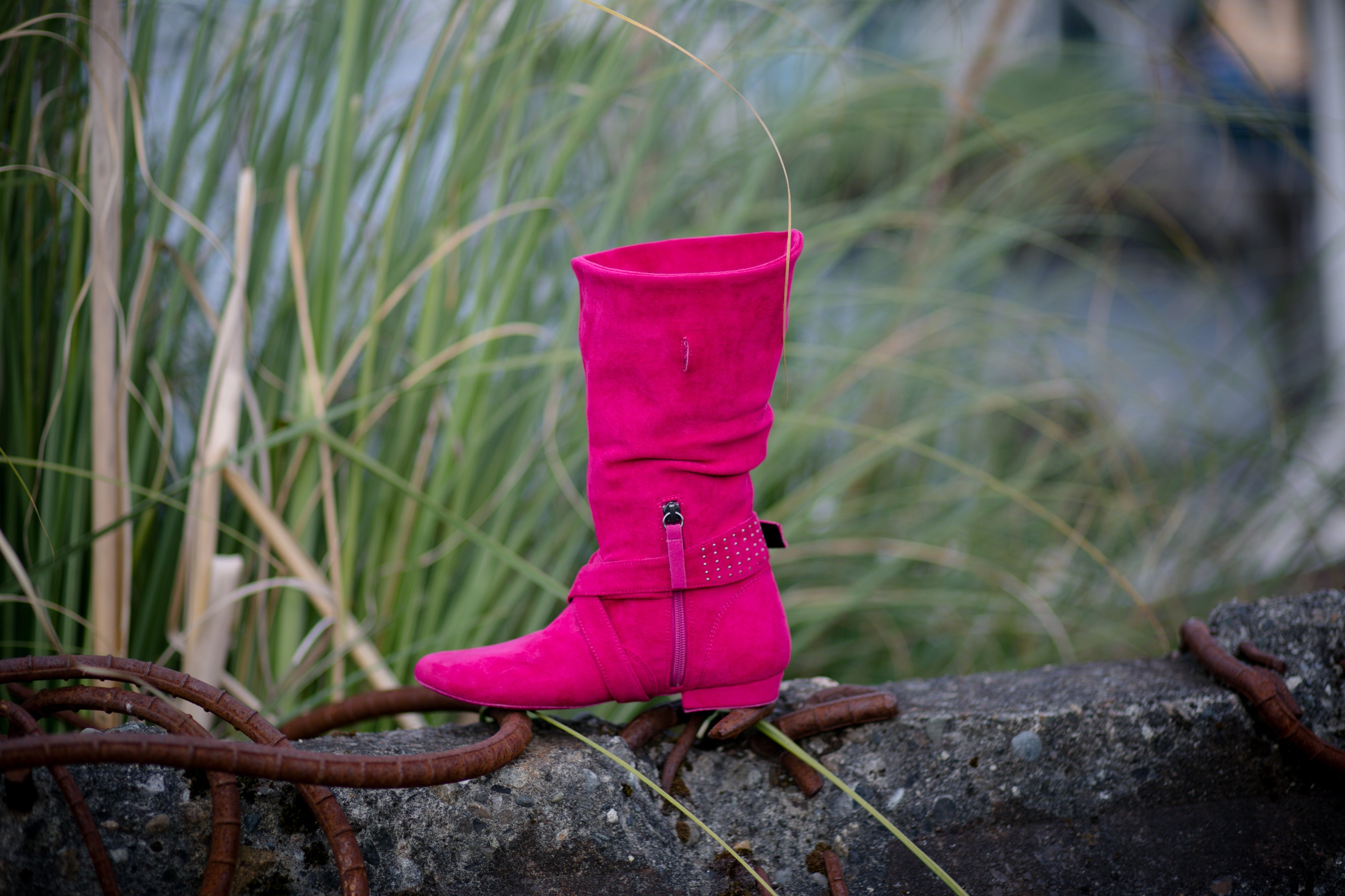 Aurora dance boots fuchsia folded up inside angle with zipper and strap