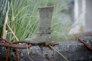 Aurora dance boots dark/olive green folded up, outside angle with MLF logo and strap