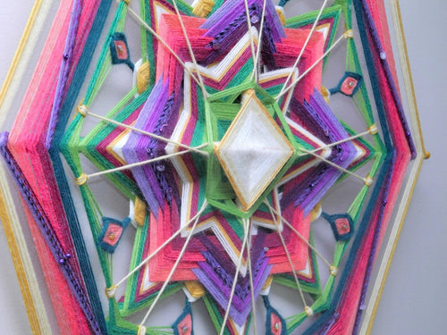 Finding Joy, a 24 inch, Ojo de Dios, by custom order
