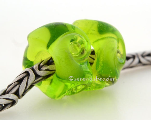 Twisted Olive Green Charm Pair A pair of transparent olive green twisted glass beads that will fit your European charm style bracelet, although the bracelet is not for sale.~~~~~~~~~~~~~~~~~~~~~~~~~~7x15 mm2 Beads5 mm hole Glossy,Matte