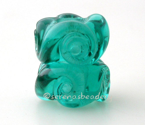 Twisted Teal Charm Pair A pair of transparent teal twisted glass beads that will fit your European charm style bracelet, although the bracelet is not for sale.~~~~~~~~~~~~~~~~~~~~~~~~~~7x15 mm2 Beads5 mm hole Glossy,Matte