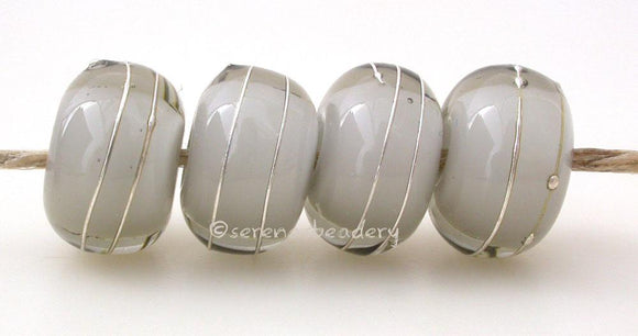 Gray White Heart With Fine Silver A gray white heart bead wrapped with strands of fine silver. 5x12 mm price is per bead Glossy,Matte