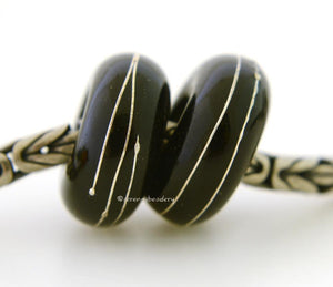 Black Fine Silver Wrap European Charm Bead one black handmade lampwork glass European charm spacer bead with a fine silver wrap6x14 mm with a 5mm holeprice is per bead Glossy,Matte