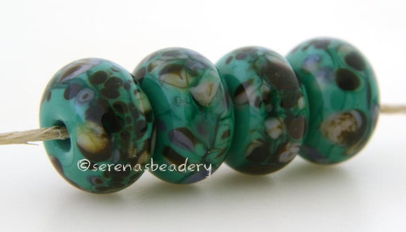 Cypress Petroleum green lampwork glass beads with purple, cream and dark brown frit.Bead Size: 6x11-12 or 7x13-14 mmHole Size: 2.5 mmprice is for one bead with a discount for 4 or more 11-12 mm,Glossy,13-14 mm,Glossy,11-12 mm,Matte,13-14 mm,Matte