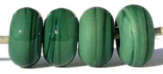 Dark Grass Green Opaque Color Notes: opaque dark green - streaky 5x10 mm Donut- This is my basic spacer size. It is made on a 3/32 mandrel with a 2.5 mm hole. Other available sizes and shapes: 4x8 mm Round- A miniature sized spacer with a 1.5 mm hole. Lentil- 12x13 mm in size with a 1.5mm hole. Pillow- 14 mm square with a 1.5 mm hole. Disk- 3x13 mm with a 2.5 mm hole. Also 6x12 mm donut- A larger donut with a 2.5 mm hole. 8x15 mm Super Sized- A humungous spacer with a 3.5 mm hole. It is perfect for stringin