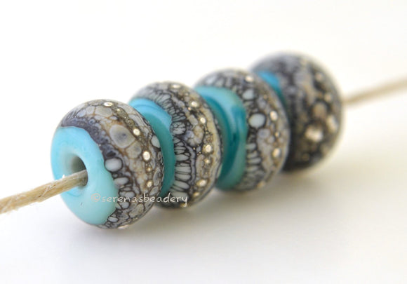 Copper Green Granite with Fine Silver Copper green, a light mint color, wrapped in silvered ivory and fine silver droplets. 5x11 mm 2.5 mm hole Price is per bead with discounts for larger quantities. Glossy,Matte
