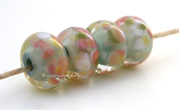 Lightly Romantic A light mint base, cased in clear and covered in cream and pink frit. Bead Size: 7x13 mm Hole Size: 2.5 mm price is for one bead with a discount for 4 or more Glossy,Matte