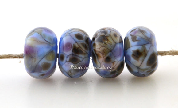 Whistle Dixie Light blue lampwork glass beads with dark brown, cream, and purple.Bead Size: 6x11-12 or 7x13-14 mmHole Size: 2.5 mmprice is for one bead with a discount for 4 or more 11-12 mm,Glossy,13-14 mm,Glossy,11-12 mm,Matte,13-14 mm,Matte