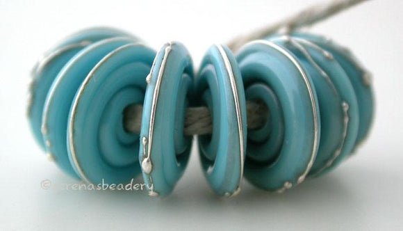Light Turquoise Fine Silver Disc Opaque light turquoise wrapped in fine silver. 3x14mm Price is per bead. Glossy,Matte