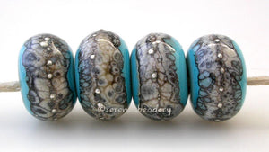 Turquoise Granite with Fine Silver Turquoise blue wrapped in silvered ivory and fine silver droplets. 5x11 mm 2.5 mm hole Price is per bead with discounts for larger quantities. Glossy,Matte