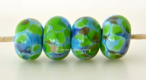 Tortuga Bay Turquoise blue lampwork glass beads with lime green, brown, and blue.Bead Size: 6x11-12 or 7x13-14 mmHole Size: 2.5 mmprice is for one bead with a discount for 4 or more 11-12 mm,Glossy,13-14 mm,Glossy,11-12 mm,Matte,13-14 mm,Matte