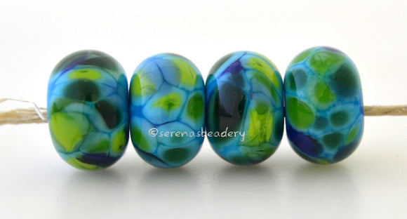 Surfs Up Dark blue lampwork glass beads with blue, dark green, lime green, and teal.Bead Size: 6x11-12 or 7x13-14 mmHole Size: 2.5 mmprice is for one bead with a discount for 4 or more 11-12 mm,Glossy,13-14 mm,Glossy,11-12 mm,Matte,13-14 mm,Matte