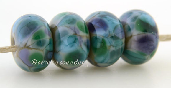 Potpourri Grey lampwork glass beads with purple, green, and steel blue frit.Bead Size: 6x11-12 or 7x13-14 mmHole Size: 2.5 mmprice is for one bead with a discount for 4 or more 11-12 mm,Glossy,13-14 mm,Glossy,11-12 mm,Matte,13-14 mm,Matte