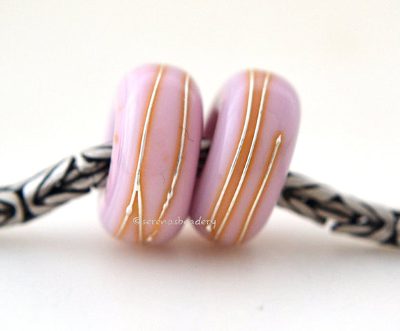 Bubble Gum Pink Fine Silver Wrap European Charm Bead one bubble gum pink handmade lampwork glass European charm spacer bead with a fine silver wrap6x14 mm with a 5mm holeprice is per bead Glossy,Matte