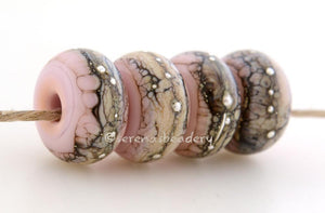 Bubble Gum Pink Granite with Fine Silver Bubble gum pink wrapped in silvered ivory and fine silver droplets. 5x11 mm 2.5 mm hole Price is per bead with discounts for larger quantities. Glossy,Matte