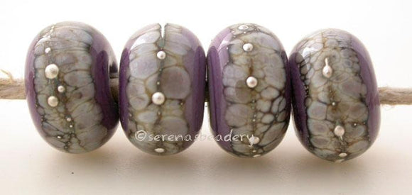 New Violet Granite with Fine Silver New Violet wrapped in silvered ivory and fine silver droplets. 5x11 mm 2.5 mm hole Price is per bead with discounts for larger quantities. Glossy,Matte