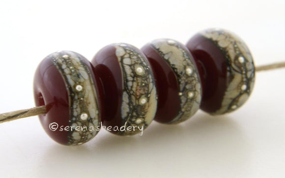 Deep Red Granite with Fine Silver Deep red wrapped in silvered ivory and fine silver droplets. 5x11 mm 2.5 mm hole Price is per bead with discounts for larger quantities. Glossy,Matte