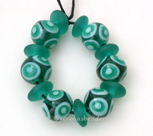 Cabana #545 ~ Transparent teal and mint green dots plus matching matte chunky discs. ~ Size: 12x13 and 6x12 mm Amount: 13 BeadsHole Size: 1.5 mm This handmade bead set is ready to ship. Default Title