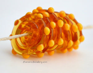 Amber Squash Dots #1592 Size: 3x20 mm ~ Amount: 6 Beads ~ Hole Size: 2.5 mm~ Six transparent amber beads with squash colored dots. ~   These beads are ready to ship! Default Title