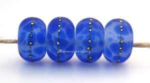 Bodacious Blue #1688 Size: 6x11 mmHole Size: 2.5 mmAmount: 4 beads~ Bold blue beads with fine silver dots. ~ These beads are ready to ship. Default Title