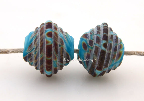 Turquoise Raku Ribbed Bicones #1718 Size: 8x13 mm ~ Amount: 2 Beads ~ Hole Size: 2.5 mm~ Turquoise blue and raku in a ribbed bicone shape in a matte finish. ~These beads are ready to ship. Default Title