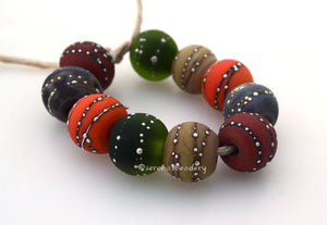 Silver Creek Bed #1732 Size: 10x11 mm, Amount: 10 Beads, Hole Size: 2.5 mm~ Another set that just looks fantastic all put together. Shades of red, orange, yellow, gray, and dusky green. ~ These beads are ready to ship. Default Title